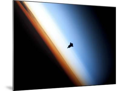 Silhouette of Space Shuttle Endeavour over Earth's Colorful Horizon--Mounted Photographic Print