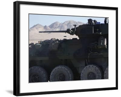 A Light Armored Vehicle Fires its 25Mm Bushmaster Chain Gun Photographic  Print by | Art com