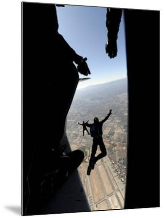 US Air Force Academy Parachute Team Jumps Out of an Aircraft over Nellis Air Force Base, Nevada--Mounted Photographic Print