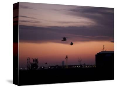 A Pair of UH-60 Black Hawk Helicopters Approach their Landing in Baghdad, Iraq--Stretched Canvas Print