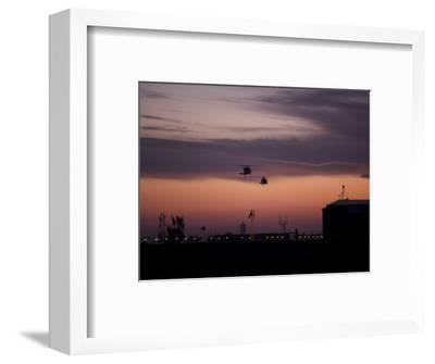 A Pair of UH-60 Black Hawk Helicopters Approach their Landing in Baghdad, Iraq--Framed Photographic Print