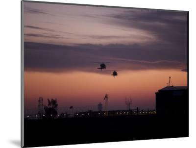 A Pair of UH-60 Black Hawk Helicopters Approach their Landing in Baghdad, Iraq--Mounted Photographic Print