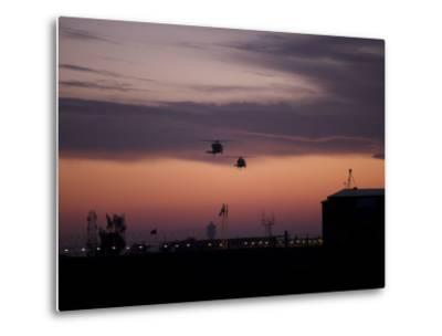 A Pair of UH-60 Black Hawk Helicopters Approach their Landing in Baghdad, Iraq--Metal Print