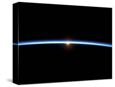 The Thin Line of Earth's Atmosphere and the Setting Sun--Stretched Canvas Print