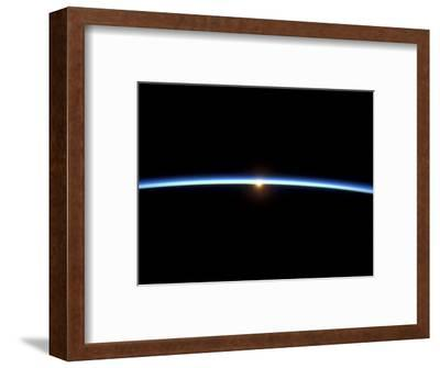 The Thin Line of Earth's Atmosphere and the Setting Sun--Framed Photographic Print