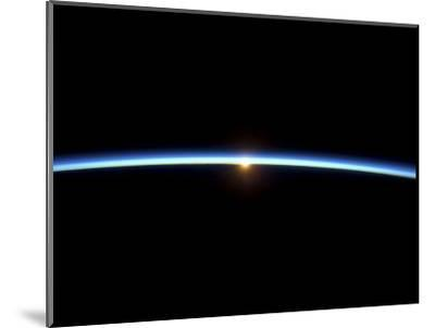 The Thin Line of Earth's Atmosphere and the Setting Sun--Mounted Photographic Print