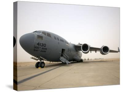 A C-17 Globemaster Iii Sits on the Runway at Cob Speicher, Iraq--Stretched Canvas Print