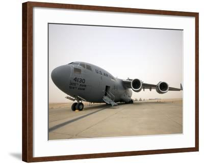 A C-17 Globemaster Iii Sits on the Runway at Cob Speicher, Iraq--Framed Photographic Print