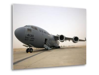 A C-17 Globemaster Iii Sits on the Runway at Cob Speicher, Iraq--Metal Print