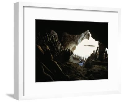 A Woman Kneels to Pray to Buddha in Sacred Cave High Above the Mekong-W^E^ Garrett-Framed Photographic Print