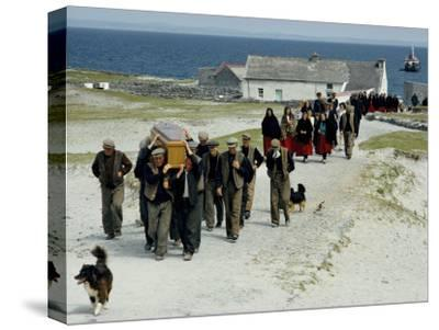 Village Men Carry a Coffin, Women in Red Skirts Follow in Procession-Jim Sugar-Stretched Canvas Print