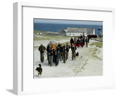 Village Men Carry a Coffin, Women in Red Skirts Follow in Procession-Jim Sugar-Framed Photographic Print