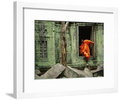 A Monk Emerges from the Doorway of an Angkor Wat Temple-Steve Raymer-Framed Photographic Print