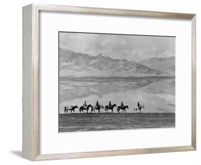 Men on Horseback Riding Along the Shore of Lake Bulun Kul-Maynard Owen Williams-Framed Photographic Print