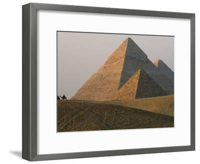 Camel Riders are Dwarfed by the Pyramids of Giza-James L^ Stanfield-Framed Photographic Print