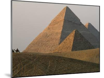 Camel Riders are Dwarfed by the Pyramids of Giza-James L^ Stanfield-Mounted Photographic Print