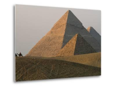 Camel Riders are Dwarfed by the Pyramids of Giza-James L^ Stanfield-Metal Print