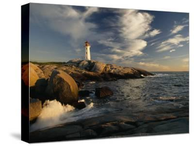 Surf Pounds the Shore Near Peggy's Point Lighthouse-James P^ Blair-Stretched Canvas Print