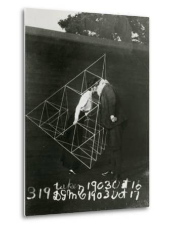 Alexander Graham Bell and Mabel Kissing Within a Tetrahedral Kite- U.S. Gov'T Library Of Congress-Metal Print