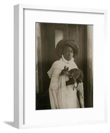 A Stylish Young Kenyan Woman Holding Her Pet Deer-Underwood & Underwood-Framed Photographic Print