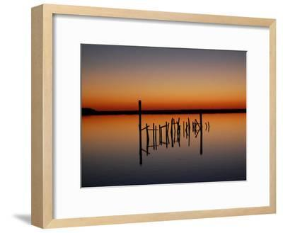 Sunset over Calm Water and a Dilapidated Old Pier-Ross Kelly-Framed Photographic Print