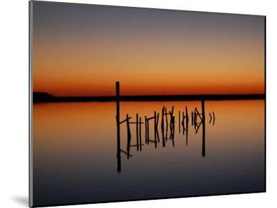 Sunset over Calm Water and a Dilapidated Old Pier-Ross Kelly-Mounted Photographic Print