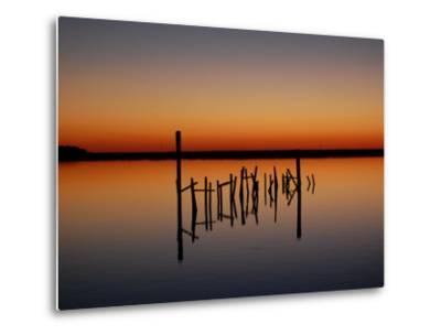 Sunset over Calm Water and a Dilapidated Old Pier-Ross Kelly-Metal Print