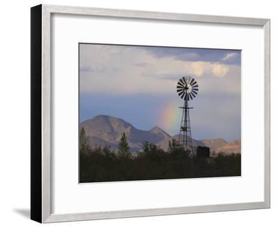 A Windmill on a Ranch with a Rainbow and Mountain Scenery-George Grall-Framed Photographic Print