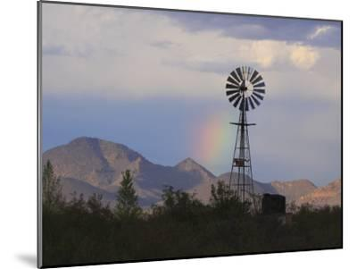 A Windmill on a Ranch with a Rainbow and Mountain Scenery-George Grall-Mounted Photographic Print