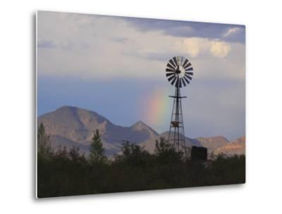 A Windmill on a Ranch with a Rainbow and Mountain Scenery-George Grall-Metal Print