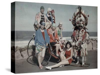 Women Pose in their Bathing Suits Near the Beach Next to a Zulu Man-Melville Chater-Stretched Canvas Print