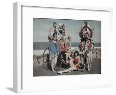 Women Pose in their Bathing Suits Near the Beach Next to a Zulu Man-Melville Chater-Framed Photographic Print