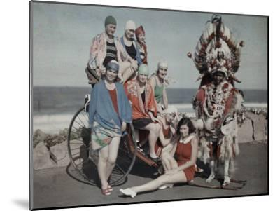 Women Pose in their Bathing Suits Near the Beach Next to a Zulu Man-Melville Chater-Mounted Photographic Print