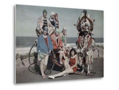 Women Pose in their Bathing Suits Near the Beach Next to a Zulu Man-Melville Chater-Metal Print