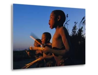 Newly Circumcised Boys from the Luvale Tribe Greet the Dawn-Chris Johns-Metal Print