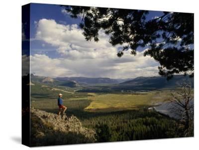A Hiker Looks over the Teton Wilderness Area, Wyoming-Raymond Gehman-Stretched Canvas Print