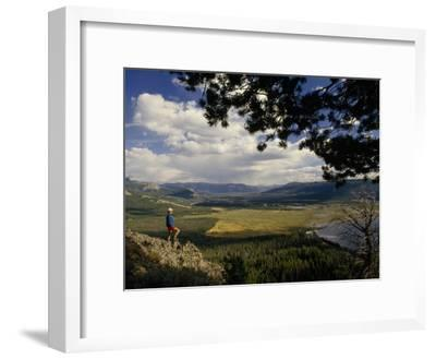 A Hiker Looks over the Teton Wilderness Area, Wyoming-Raymond Gehman-Framed Photographic Print