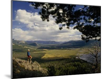 A Hiker Looks over the Teton Wilderness Area, Wyoming-Raymond Gehman-Mounted Photographic Print