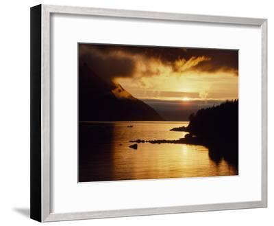 Cloud-Filtered Sunset Silhouettes a Boat on the Sheltered Waters of Bonne Bay-Raymond Gehman-Framed Photographic Print