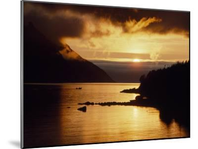 Cloud-Filtered Sunset Silhouettes a Boat on the Sheltered Waters of Bonne Bay-Raymond Gehman-Mounted Photographic Print