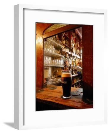 A Pint of Dark Beer Sits in a Pub Service Window-Jim Richardson-Framed Photographic Print