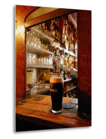 A Pint of Dark Beer Sits in a Pub Service Window-Jim Richardson-Metal Print