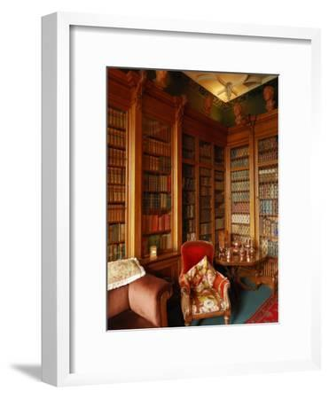 A Red Chair Sits Amid Shelves of Books in Balfour Castle's Library-Jim Richardson-Framed Photographic Print
