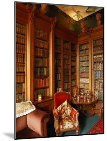 A Red Chair Sits Amid Shelves of Books in Balfour Castle's Library-Jim Richardson-Mounted Photographic Print