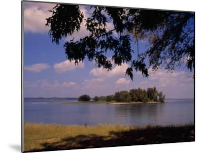 Small Island in Kentucky Lake Framed by Tree Branches-Raymond Gehman-Mounted Photographic Print