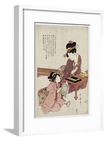A Young Woman Seated at a Desk, Writing, a Girl with a Book Looks On-Kitagawa Utamaro-Framed Giclee Print