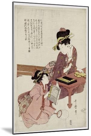 A Young Woman Seated at a Desk, Writing, a Girl with a Book Looks On-Kitagawa Utamaro-Mounted Giclee Print
