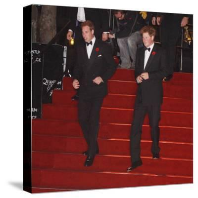 Prince William (left) and his brother Prince Harry arrive for the world premiere of the new James B--Stretched Canvas Print