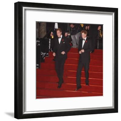 Prince William (left) and his brother Prince Harry arrive for the world premiere of the new James B--Framed Photographic Print