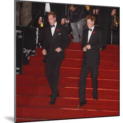 Prince William (left) and his brother Prince Harry arrive for the world premiere of the new James B--Mounted Photographic Print